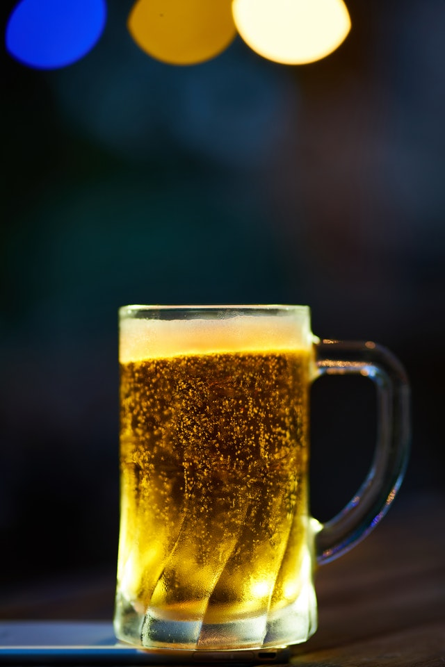 clear-glass-mug-filled-with-yellow-liquid-1672304