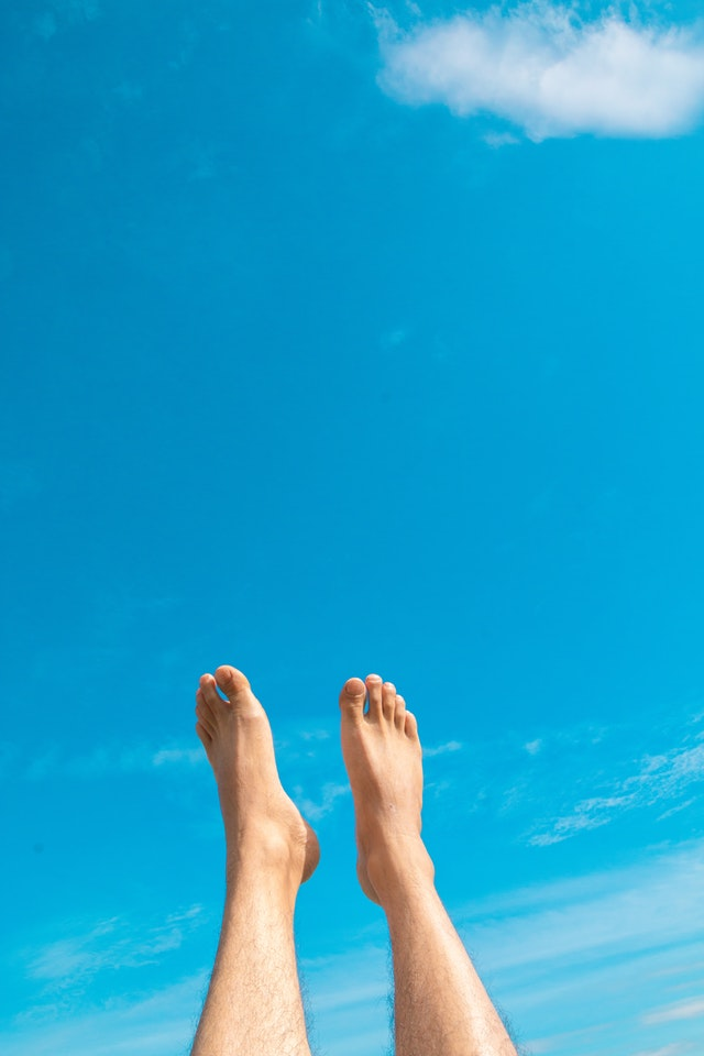 closeup-photo-of-person-s-feet-in-the-air-1721025